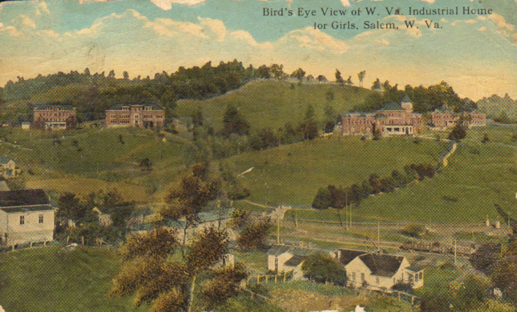 Color postcard of a bird's eye view of the West Virginia Industrial Home for Girls in Salem, WV. The industrial home campus is situated on the hill above the town. Courtesy of Harrison County WV Historical Society