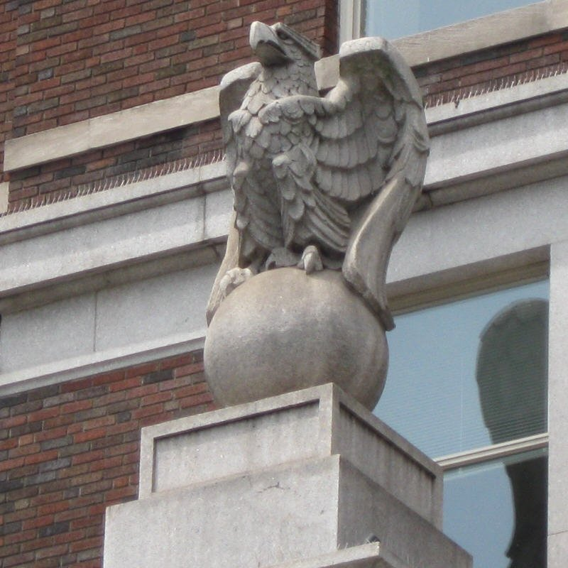A close-up of one of those eagles, the symbol of the Insurance Company of North America.