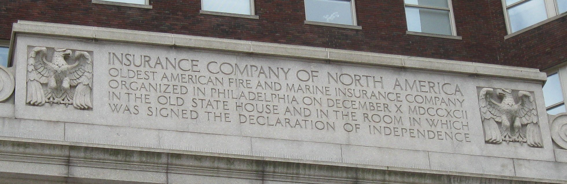 The inscription on the building that commemorates the founding of INA.