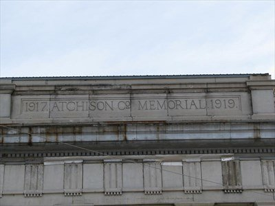 The inscription on top of the building along with the dates that the United States was involved in World War I.