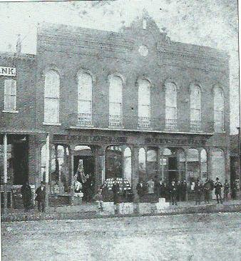 Burlingame and Chaffee Opera House building showing two storefronts on the first floor, circa 1878-80.