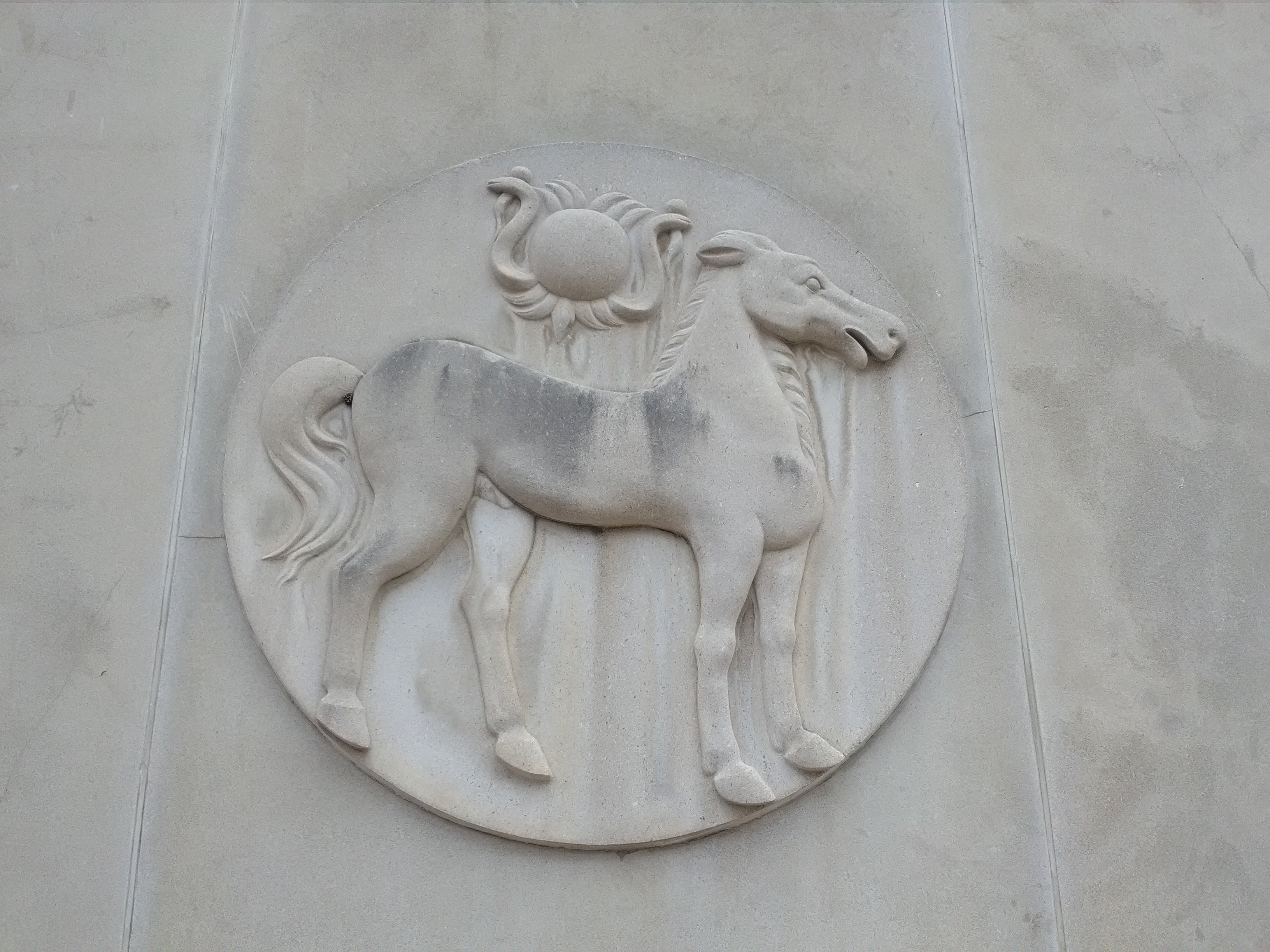 One of several stone sculptures on the West Fourth Street side of the former Bank of Carthage building.