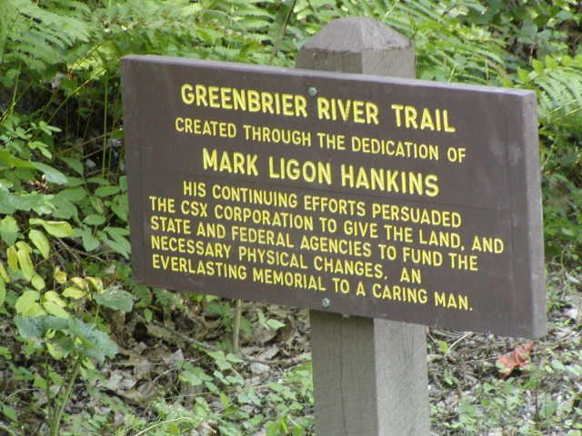 A sign along the Greenbrier River Trail tells of the efforts of Mark Ligon Hankins towards the establishment of the trail. Courtesy of J. Watson.5