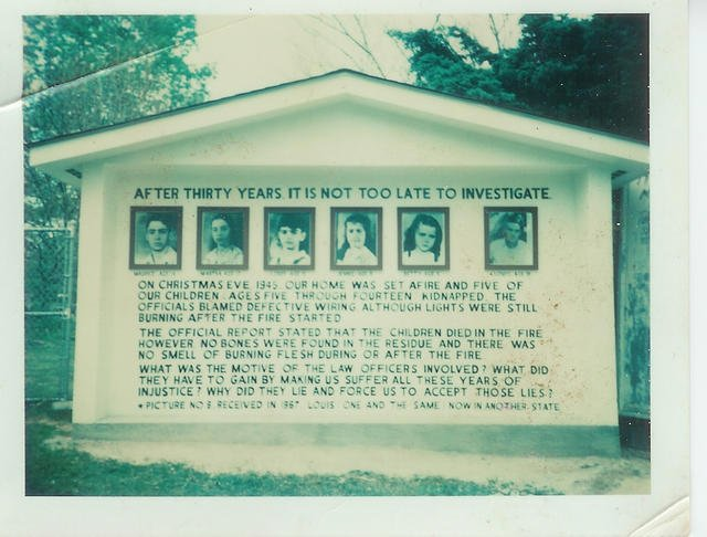 The sign, which sat along WV-16, told the story of the five children gone missing.