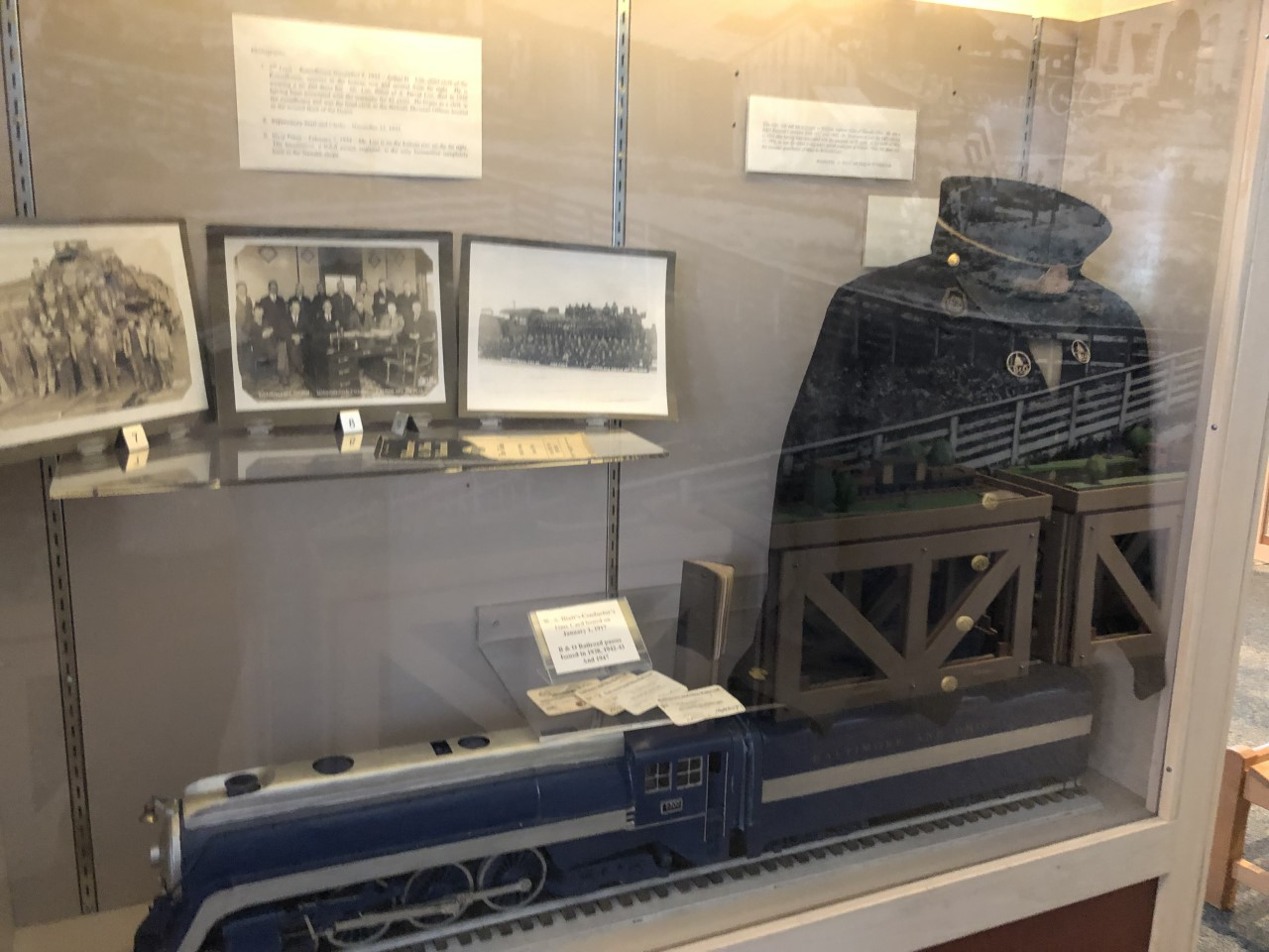 A variety of B&O memorabilia is on display, including photos, a model engine, and a uniform belonging to William Andrew Hiatt, B&O conductor from 1917 to 1942.