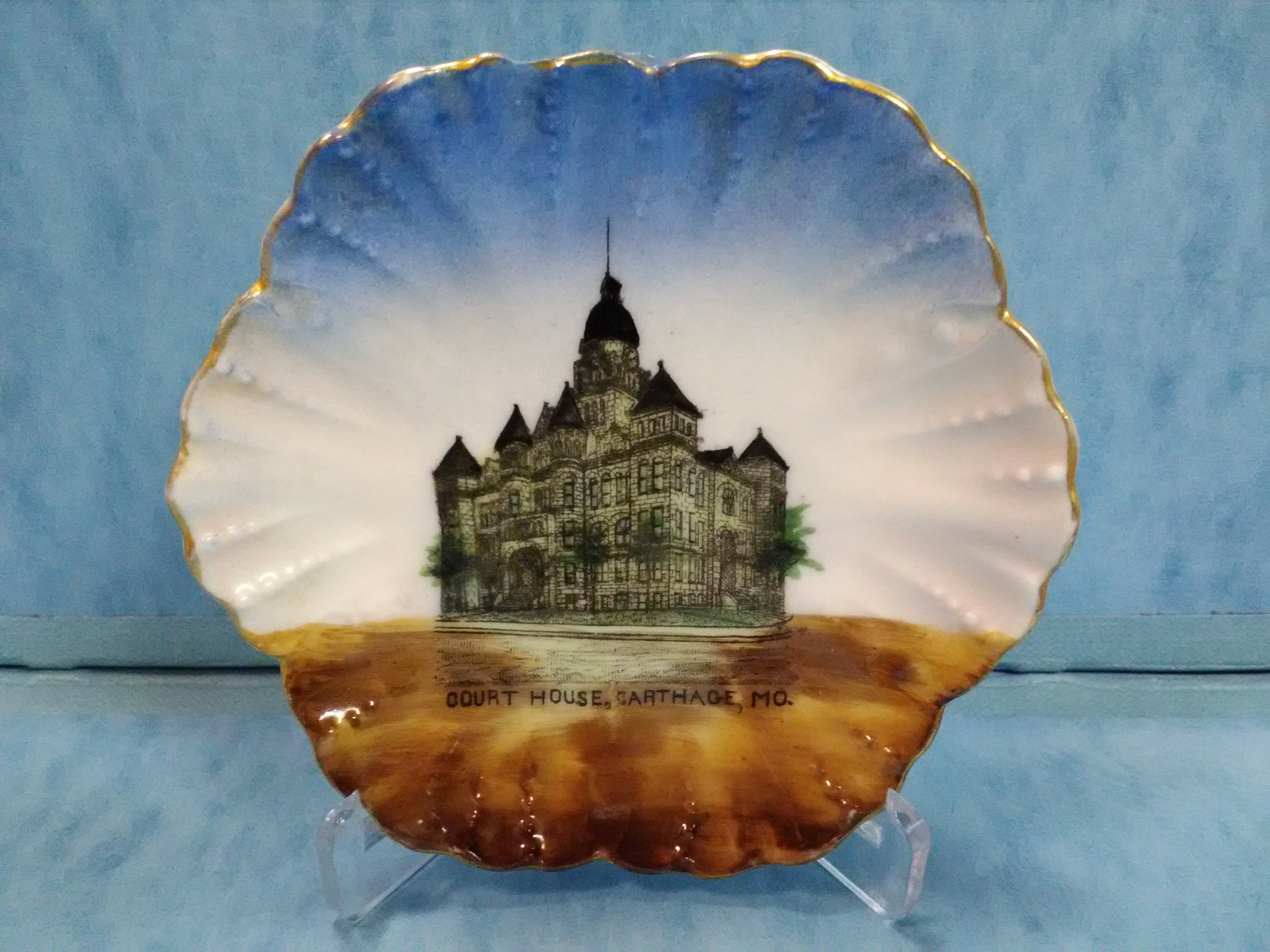Front of pin dish sold in W. T. Roach store at this location. The hand-painted decoration features an image of the Jasper County Courthouse built in 1894-95.