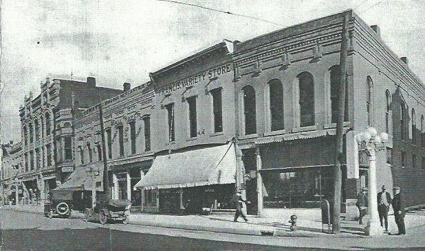 Image of facades of older buildings (left of the McDaniel Building at the right corner) that became incorporated into the Steadley Building in the late 1920s. The historic image is from the 1910s.