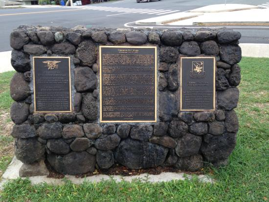 The back side of the monument displays three plaques. Names of SEALs, Operation Red Wings description, and  names of Night Stalkers.