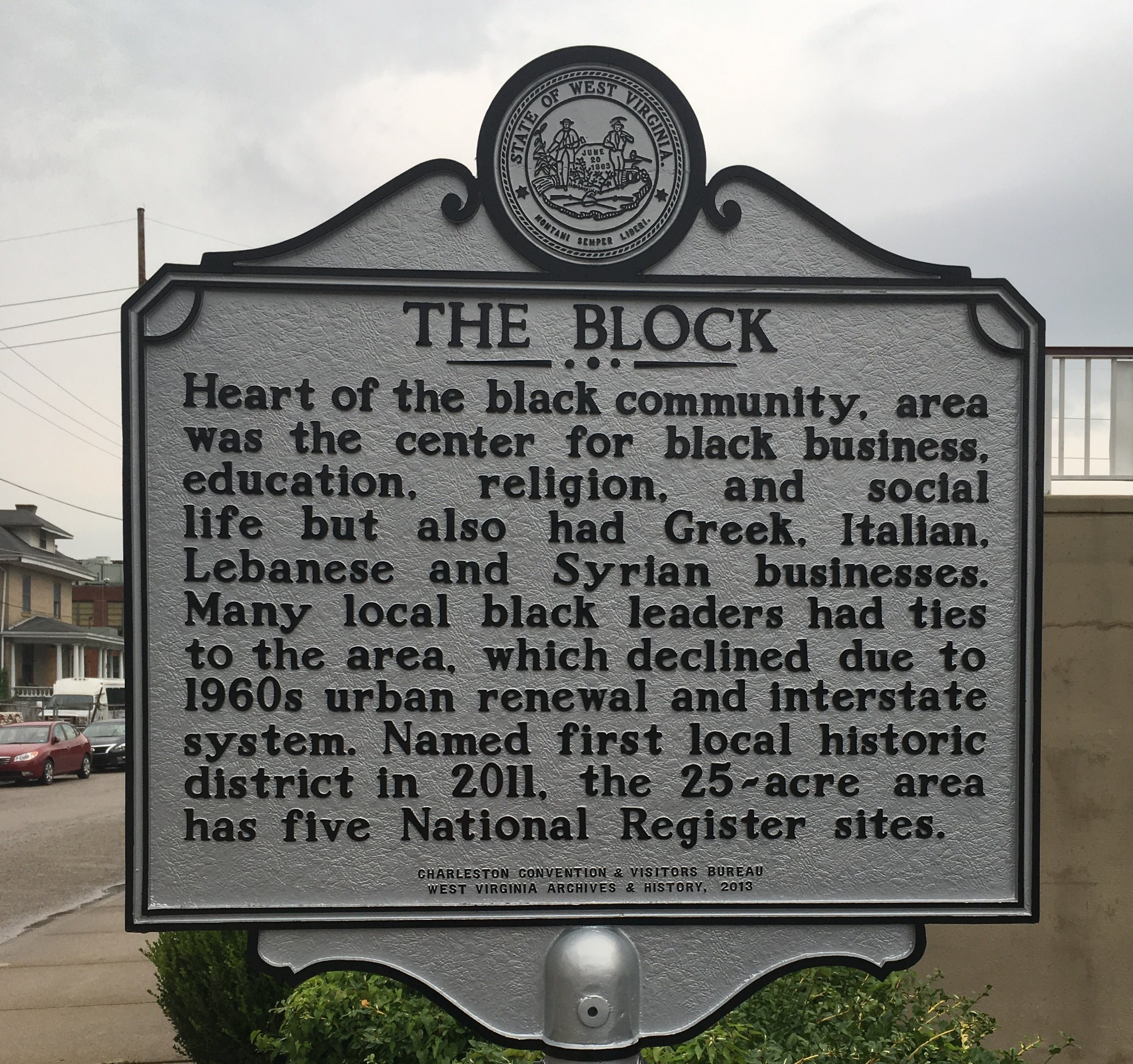 Historical marker placed in 2013 by the WV Center for African American Art & Culture, Inc.  The marker is located in the parking lot of a current Charleston hotel (formerly the site of the segregated black only Ferguson Hotel).
