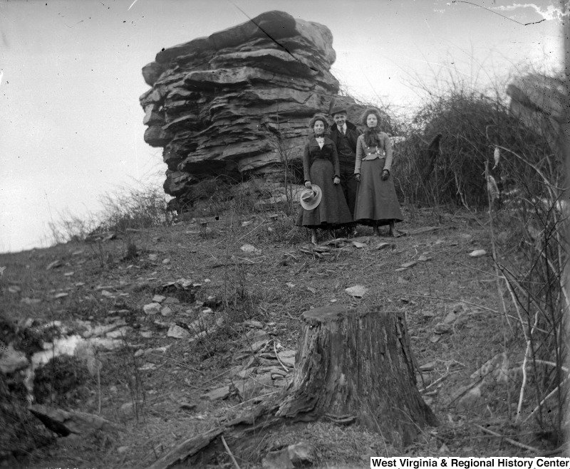 An undated photo showing two women and a man beside Sky Rock.