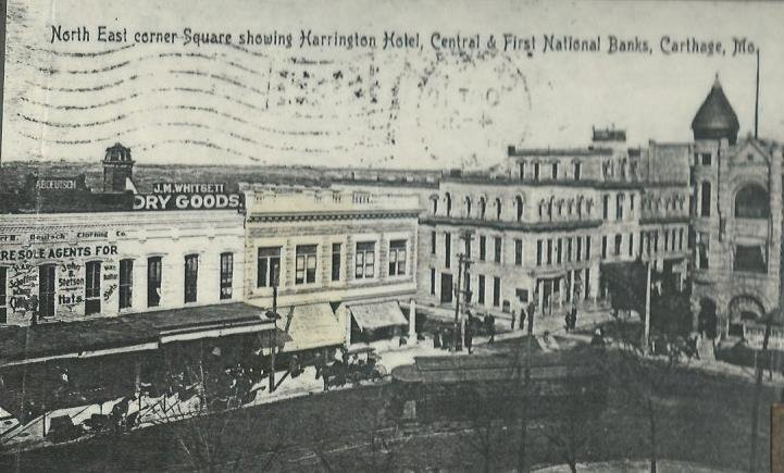 Postcard image of north east corner of square showing Central National Bank building as well as its neighbors to the west (Deutsch Clothing and Whitsett's Dry Goods) and its neighbor to the east  (Harrington Hotel), circa 1906-10.
