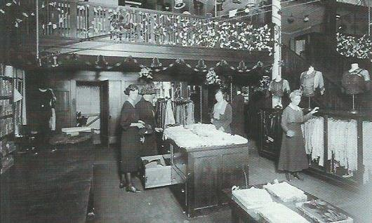 Interior of building when Burkett-Andrews Dry Goods occupied this address in 1921. Store is decorated for Christmas. (1)