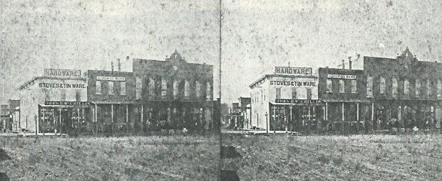 McCrillis Brothers early hardware, stoves and tinware store at corner of 4th and Grant streets, circa 1878-79. Burlingame and Chaffee Opera House (now 136 E. 4th) can also be seen in this stereo view image. (1)