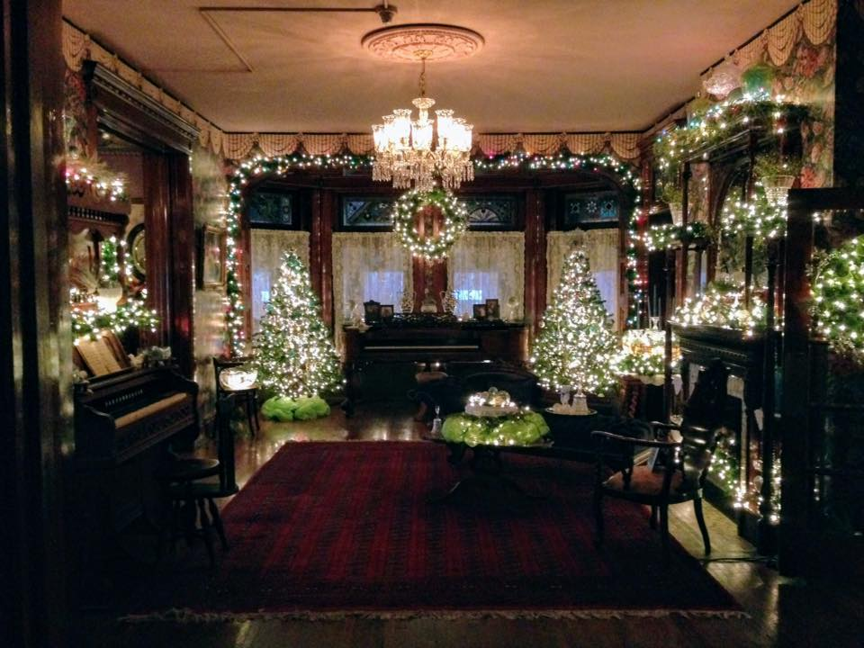 The historic home decorated for the holidays