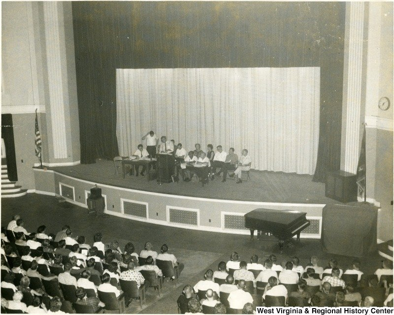 Group seated on the stage of the Morgantown High School auditorium before an audience. Date unknown. Courtesy of the West Virginia and Regional History Center.