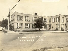 Partial view of the Carmo Shoe Manufacturing Company located at the corner of Garrison Avenue and Oak Street (also known as U.S. 66 and U.S. 71 at the time of this image, circa 1930s).