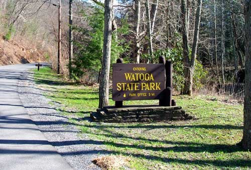Pictured is the entrance sign to Watoga State Park, which notifies visitors that the park office is 5 miles from that point.