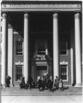 Students sitting on the steps of the Frederick Douglass Memorial Hall, 1942