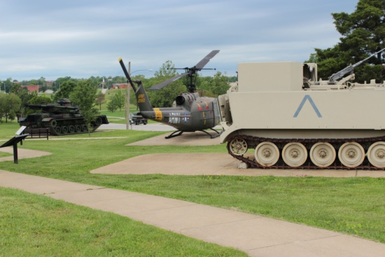Military Vehicle Complex - image features armored vehicles and a Huey