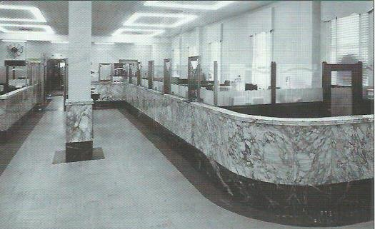 Interior of Bank of Carthage Building, circa late 1940s. H. E. Williams light fixtures are visible in the ceiling. The marble wainscotting around the center column can be seen today inside the Carthage Deli.