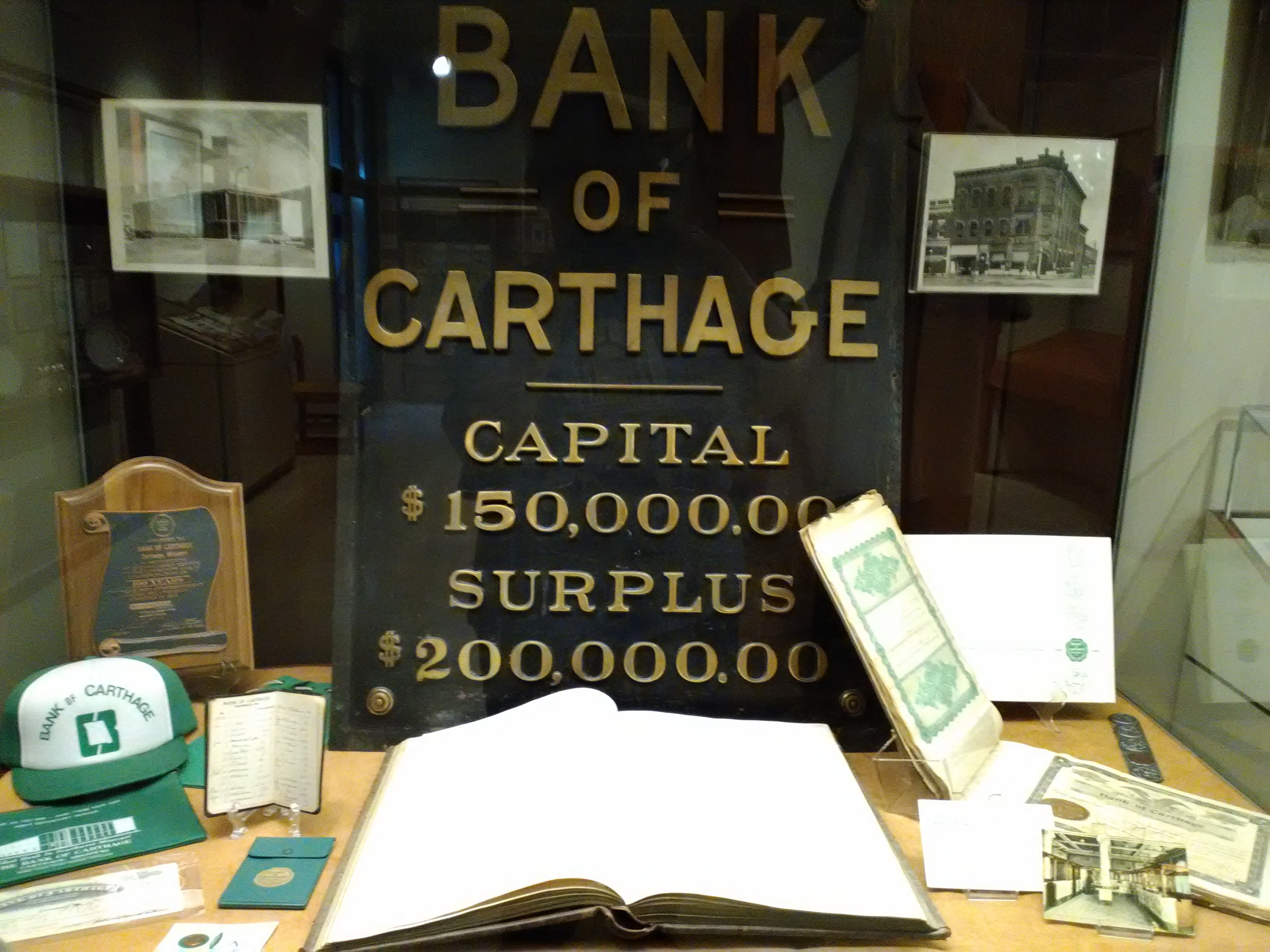 Bank of Carthage items including one of two building signs owned by the Powers Museum on display for the 175th Anniversary of Carthage Exhibit in 2017.