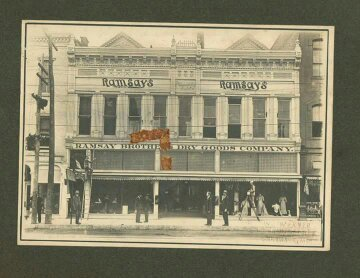 Ramsay's Brothers Dry Goods Company pre-1917 facade of the second Pollard Building. Note, two storefronts have been united into one store.