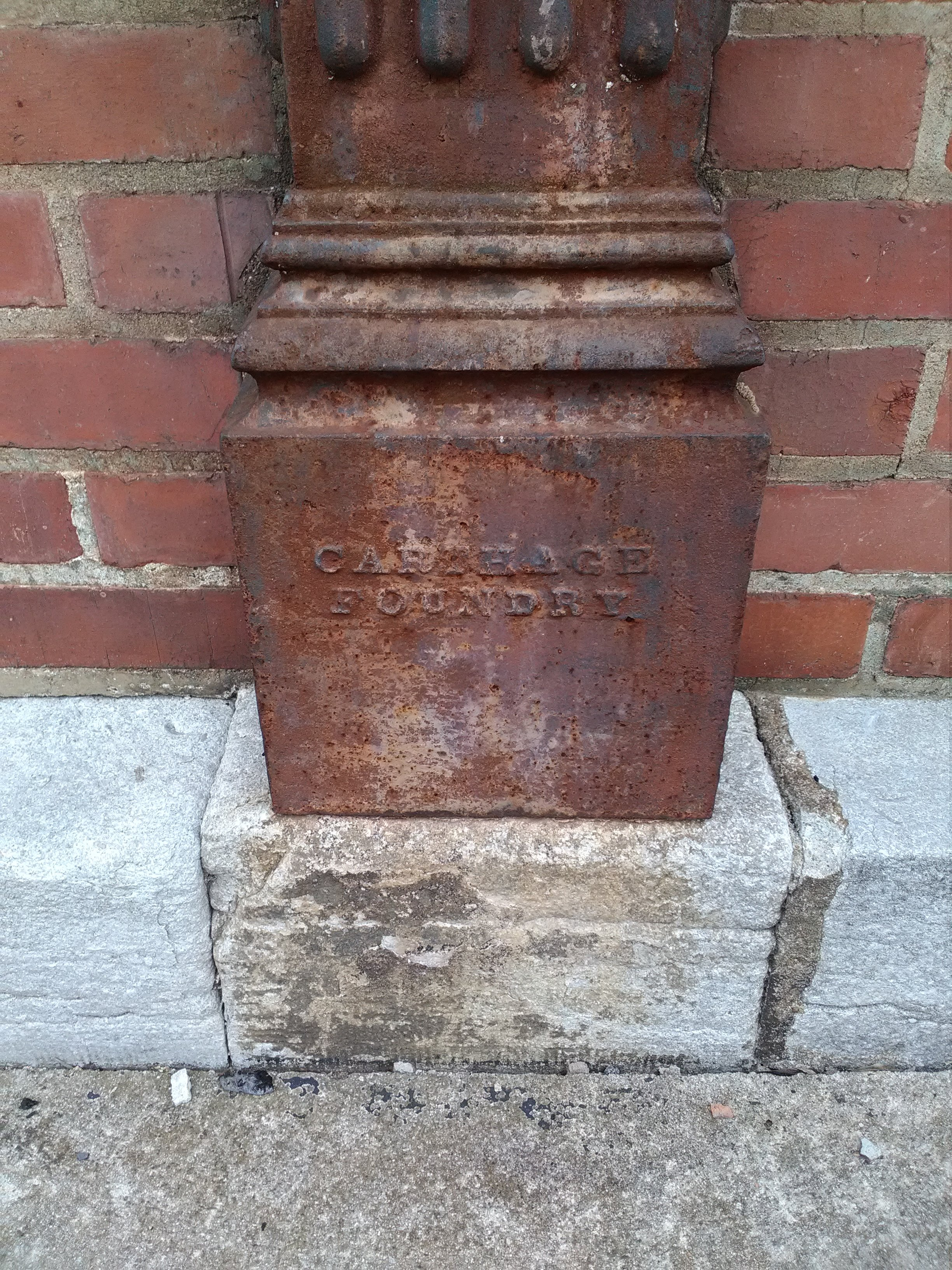 Carthage Foundry name at bottom of cast iron pillar details.