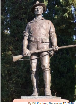 The Hiker, The statue is 9 feet tall and stands on a 6-foot granite base, representing a soldier clad in a period uniform with a campaign hat and a Krag-Jørgensen rifle.