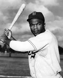 A famous snapshot of Jackie Robinson at bat playing for the Brooklyn Dodgers.