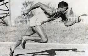 Mack Robinson running the 200m.