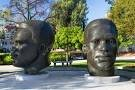 "Bronze head statues commemorating the legendary Jackie Robinson and his brother, ""Mack"" Robinson."
