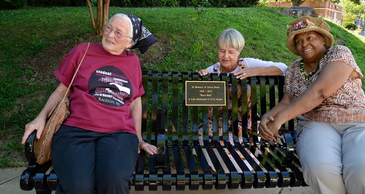 Members of the Student Nonviolent Coordinating Commitee, Joan Mulholland, left, and Joyce Ladner, right, joined Julian Bond's widow, Pam Horowitz, middle, at the dedication of the bench on June 26, 2017.