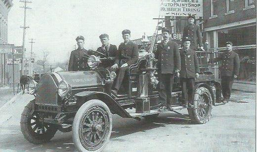 Carthage firemen outside City Hall building on Grant Street circa 1914-15. Pictured are Carthage's second Fire Chief S S Mathews (third from left) and firemen (left to right) Neely, Whiteman, Wheeler, Huffer, Ayler, and Woods (no first names).