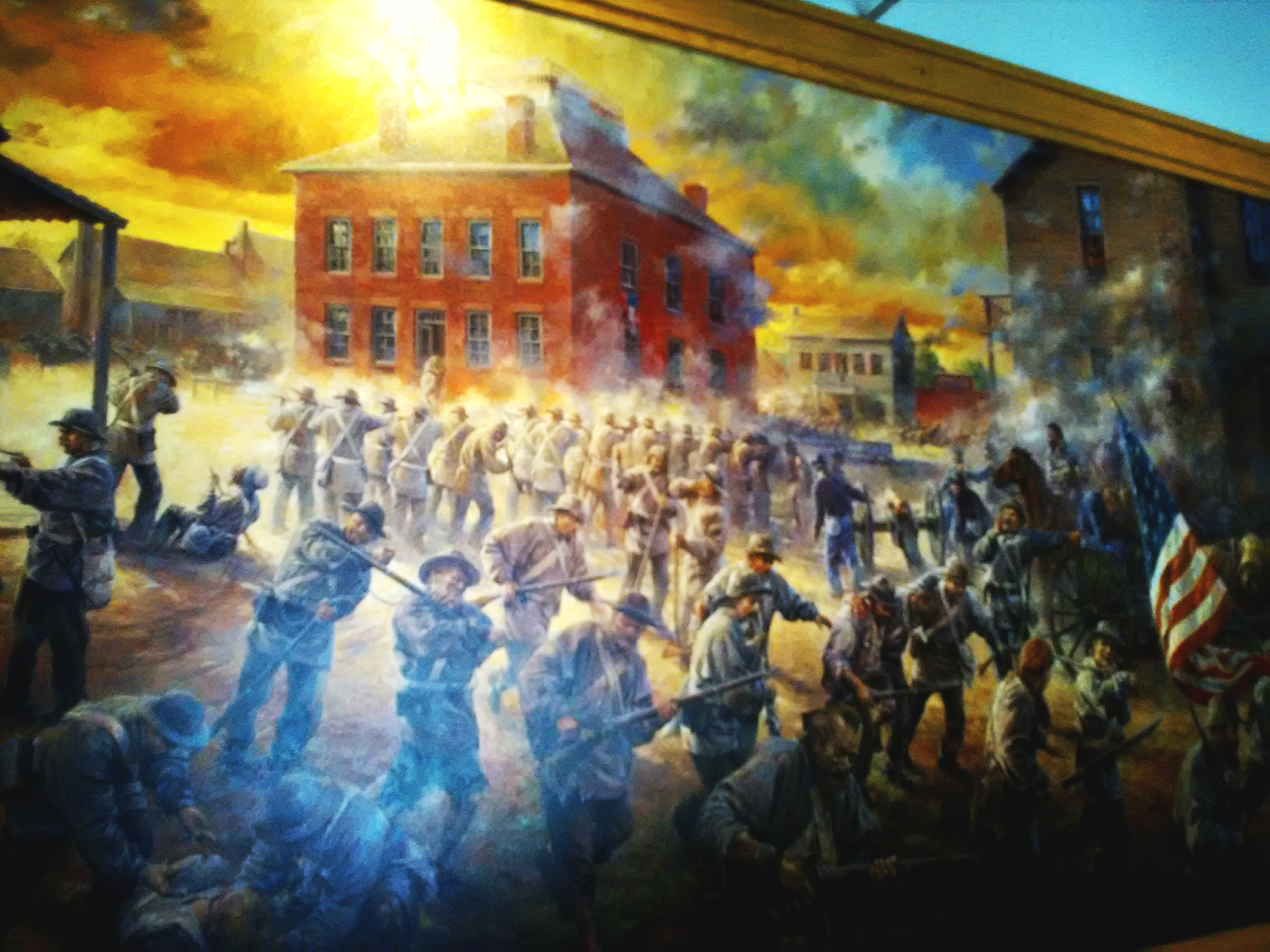Part of larger mural on the Battle of Carthage that greets visitors entering the Civil War Museum. The work was created by Carthage artist Andy Thomas and features battle action around the former Jasper County Courthouse.