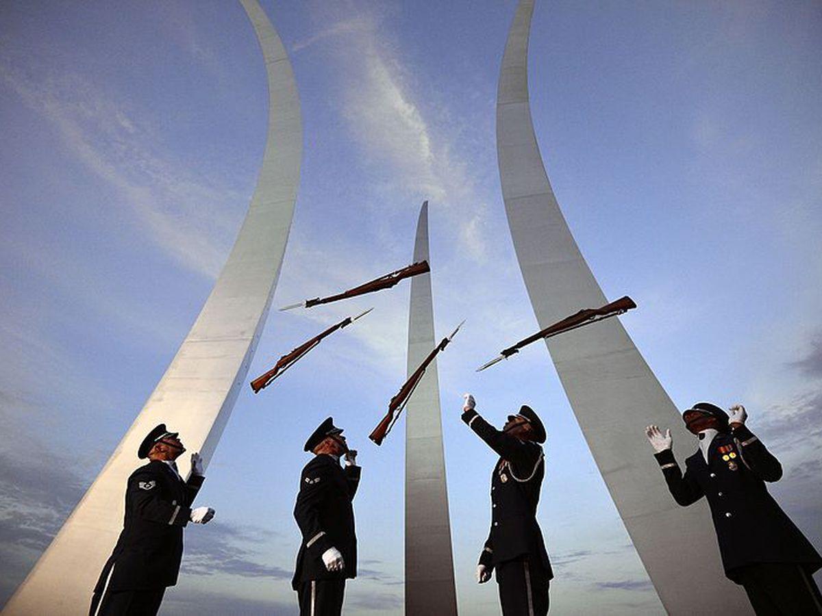 U.S. Air Force Honor Guard members performing in front of the memorial