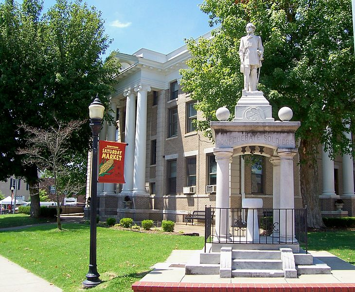 The Confederate Soldier of Murray stands tall in front of the Calloway County Courthouse. The water fountain can still be seen today inside the monument.