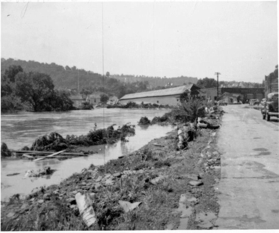 The bridge at its final resting place against the cement bridge next to West Union's Chevrolet building.
