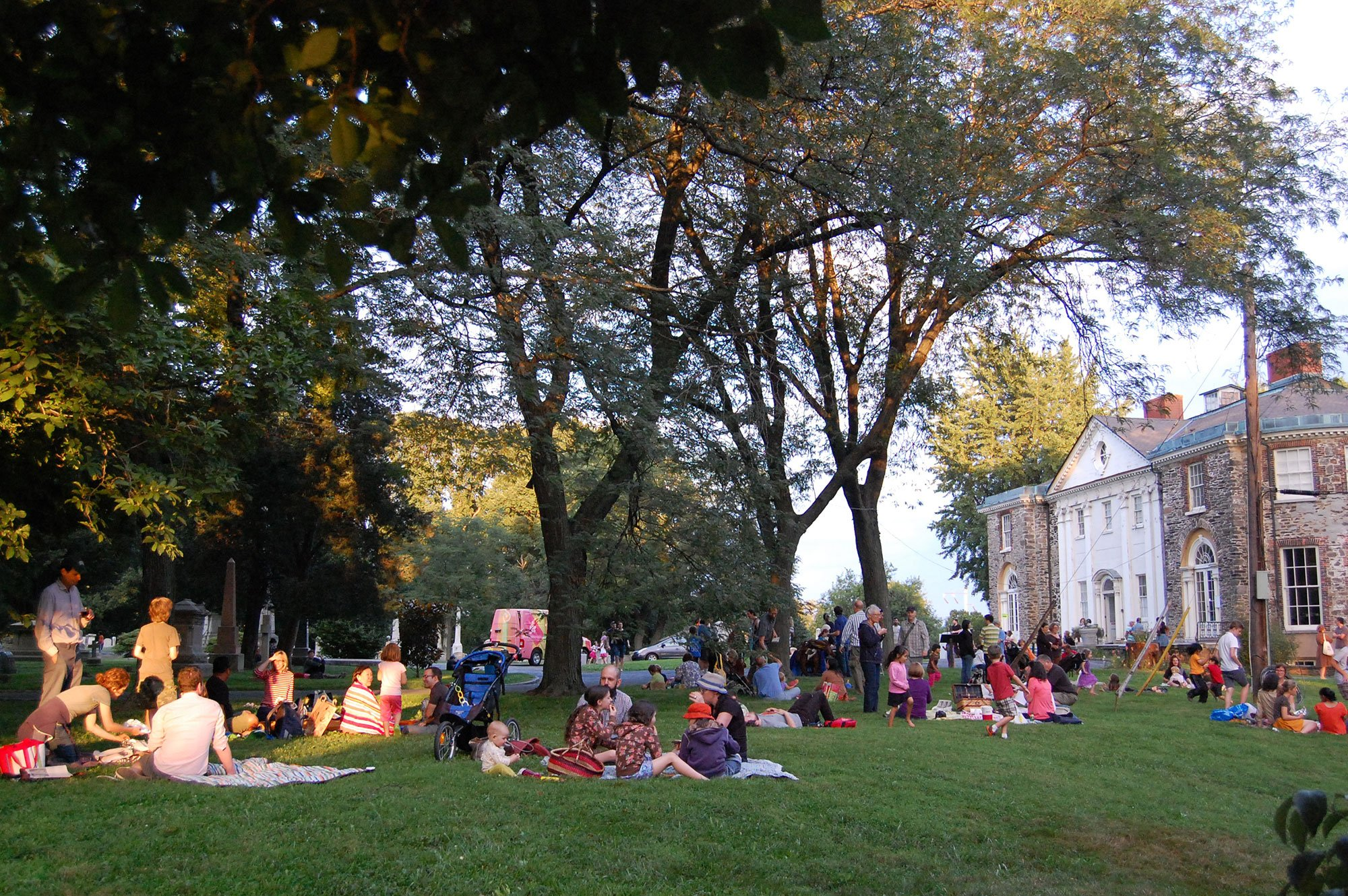 Visitors gather on the back lawn of the Woodlands mansion.