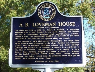 This historical marker stands on the sidewalk in front of the house.