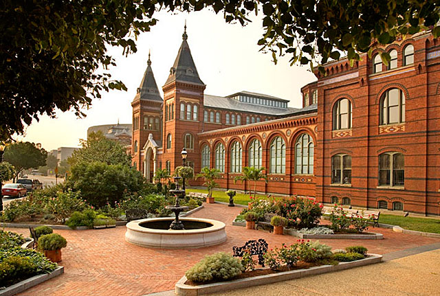 The Arts and Industries Building complements the red brick of the Smithsonian Castle and presents a unique design on the National Mall. Photo courtesy of the Smithsonian Institution.