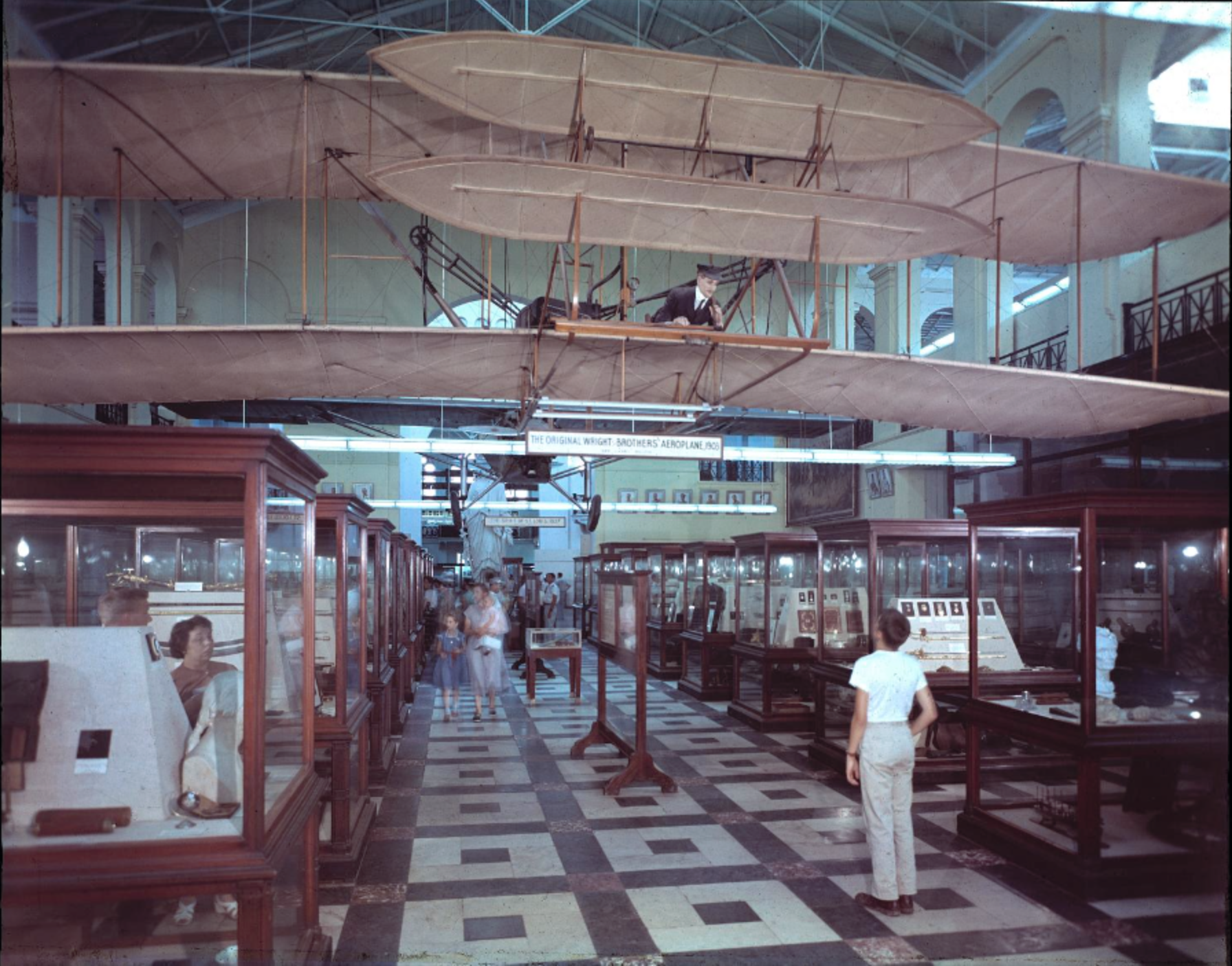 The 1903 Wright Flyer hangs in the North Hall of the Arts and Industries Building. Photo circa 1950s, courtesy of the Smithsonian Institution Archives.