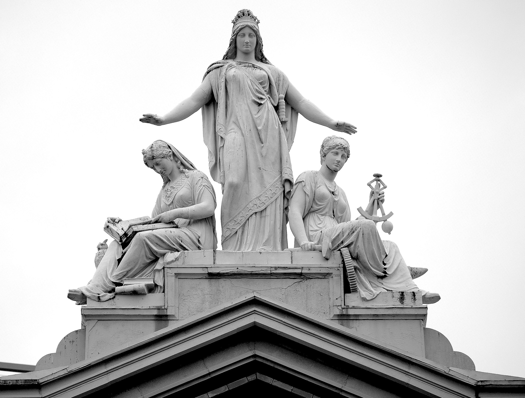 The statue atop the Arts and Industries building depicts Columbia protecting Science and Industry. Photo by Jamieadams99 on Wikimedia.