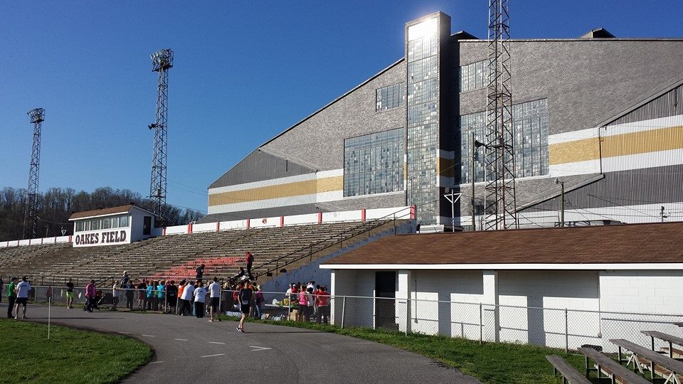 The Charleston Ordnance Center (now South Charleston Industrial Park), which produced an immense amount of naval weaponry during WW2, towers over the bleachers and pressbox of Oakes Field.