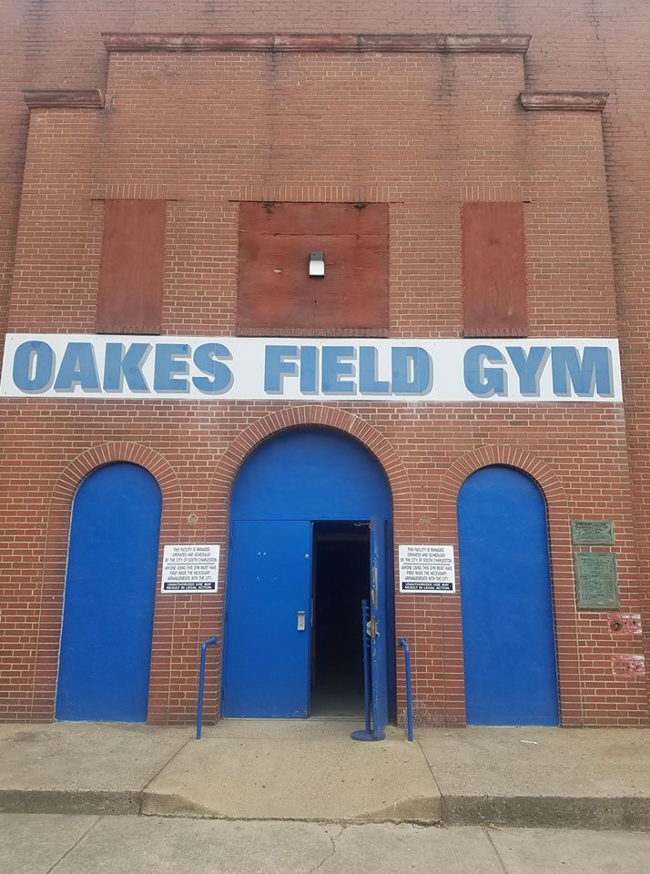 The entrance facade of the Oakes Field Gym, which houses the accompanying basketball court and support facilities. The Works Progress Administration constructed many such facilities around the country during the Great Depression.