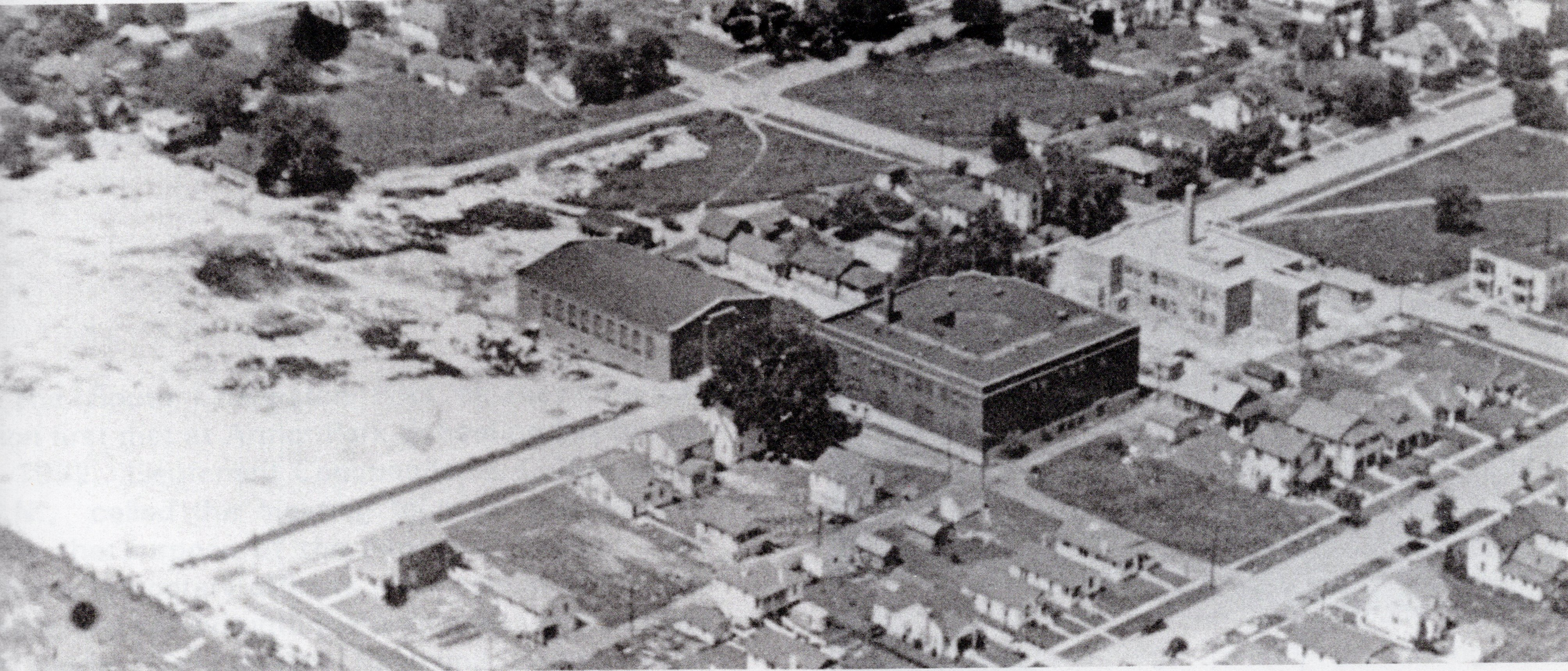 An aerial view of Oakes Field under construction (far left) circa 1941. Note that the Oakes Gymnasium has already been completed (center).