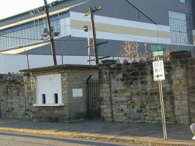 A closer view of the stone wall and ticket booth on F. Street, with the Charleston Ordnance Center in background. Photo by Bob Lilley.