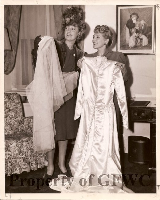 Women's clubs contributed to national efforts during both World Wars in a huge variety of ways, including a drive to donate wedding dresses to newly-married British servicewomen. Here, actress Mary Pickford donates her dress. Courtesy of the GFWC.