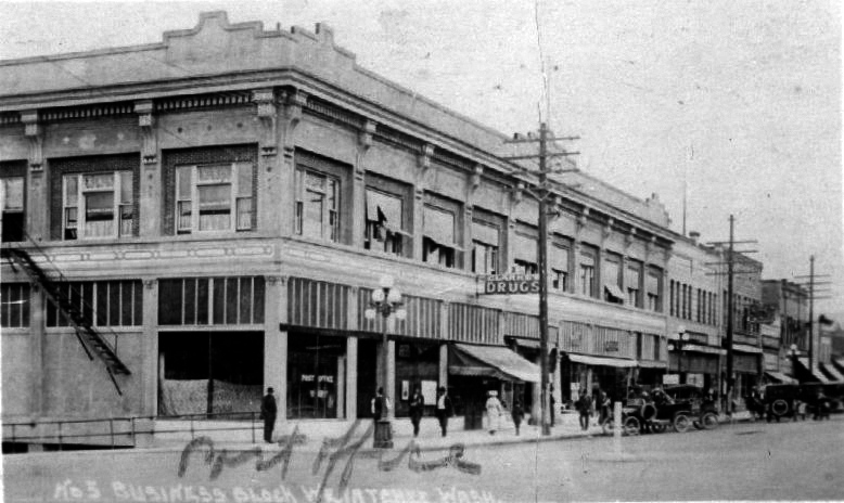 The Central Building located on the southeastern corner of North Wenatchee Avenue and First Street housing the Wenatchee Post Office, Clarke's Drug and other businesses in 1912.
