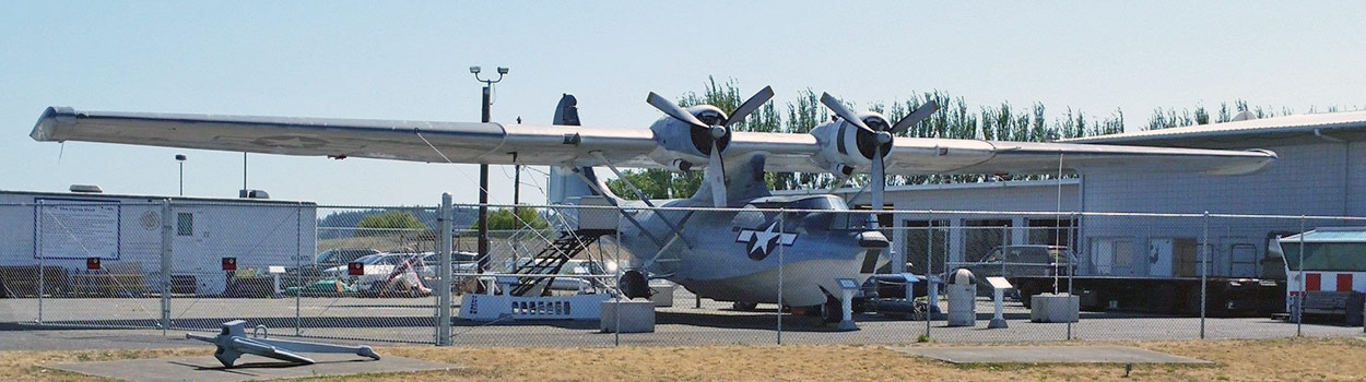 The museum's restored PBY is on display across the street from the museum building.