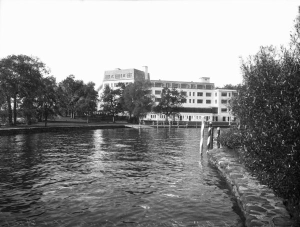 A view of the Lawsonia Hotel (now Roger Williams Inn) from Green Lake.